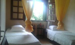 A bed or beds in a room at Holiday Home Villa Kay Malouz