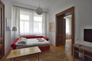 Posteľ alebo postele v izbe v ubytovaní Apartment Josefská 2
