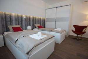 Krevet ili kreveti u jedinici u objektu Apartments City Center Zagreb