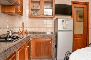 Køkken eller tekøkken på casa vacanza il nido