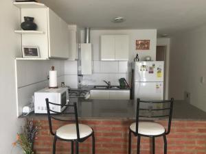 Una cocina o kitchenette en Paso 284