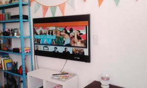 Una televisión o centro de entretenimiento en Dpto 301 y Playa