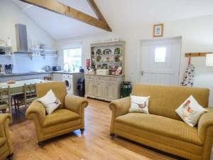 A seating area at Brooksides Byre Durham Country Cottage