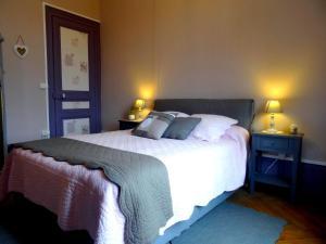 Un ou plusieurs lits dans un hébergement de l'établissement L'Ajoussienne