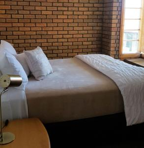 A bed or beds in a room at Stanley Village Waterfront Accommodation