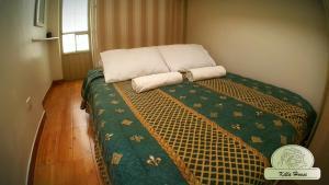 Cama o camas de una habitación en Munay killa