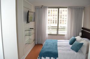 Cama o camas de una habitación en Home Valdivia Providencia