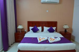 A bed or beds in a room at Al Karam Hotel Apartment