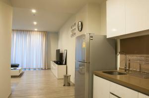 Кухня или мини-кухня в Baan Plai Haad Seaview 70 sq.m