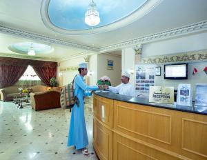 The lobby or reception area at Nuzha Hotel Apartments