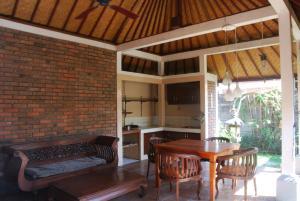 Coin salon dans l'établissement Wikarmas Villa Sanur