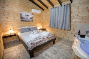 A bed or beds in a room at Golan Heights Chalets
