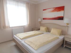 Ein Bett oder Betten in einem Zimmer der Unterkunft Sundance Mountain Resort