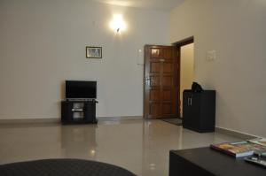 A television and/or entertainment center at Jyothi Suites