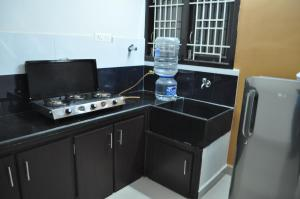 A kitchen or kitchenette at Jyothi Suites