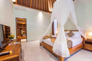 A bed or beds in a room at Sweet Ginger Villa
