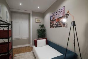 Cama ou camas em um quarto em Ola Lisbon - Principe Real III