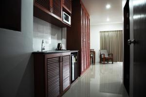 A kitchen or kitchenette at Naiharn Beach Road Apartment