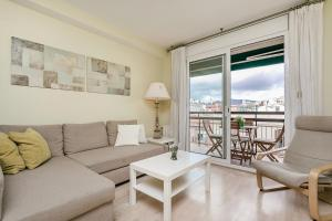 A seating area at Elegant 3bed with views of Sagrada Familia