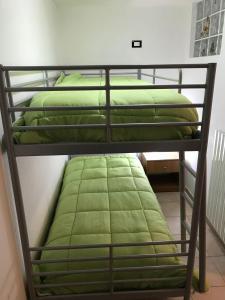 A bunk bed or bunk beds in a room at Residenze Macerelli