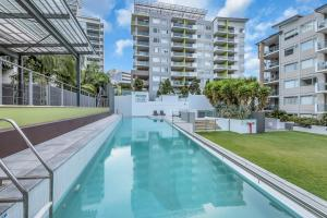 The swimming pool at or close to Trilogy Residences Brisbane