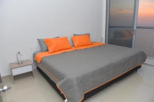 A bed or beds in a room at 41st Floor - Morroscity - Sea and City View!