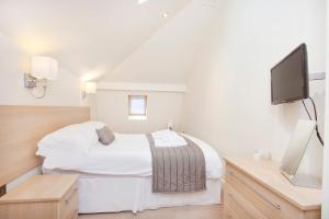 A bed or beds in a room at Saint Georges Keep