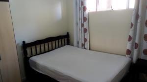 Cama o camas de una habitación en Praia Norte