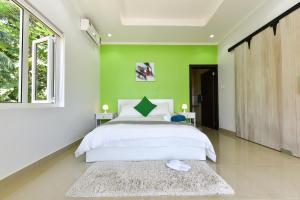 A bed or beds in a room at Moulin Kann Villas