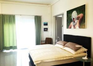 Art Apartment Winterhafen 객실 침대