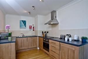 A kitchen or kitchenette at De Vere Cotswold Water Park Apartments