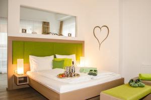 מיטה או מיטות בחדר ב-Aparthotel Bergtraum