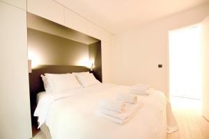 Cama ou camas em um quarto em Dreamyflat com - St Germain