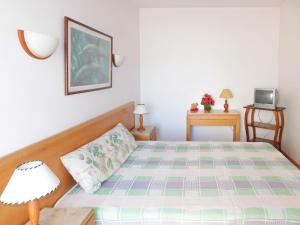 A bed or beds in a room at Apartment Belo Horizonte