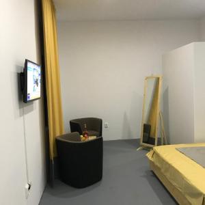 Una televisión o centro de entretenimiento en Central Park Studio