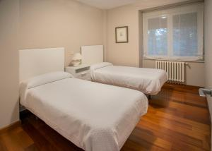 A bed or beds in a room at La Alberca