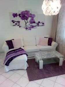 Ein Sitzbereich in der Unterkunft Orchidee