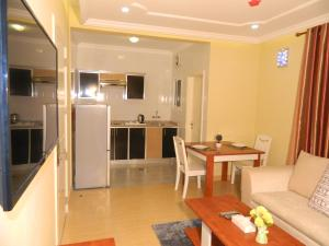 A kitchen or kitchenette at Wanasa Hotel Apartments