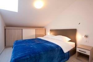 A bed or beds in a room at Vila Novak