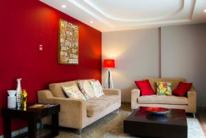 A seating area at Aparthotel Sevilla Suites