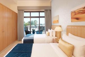 Krevet ili kreveti u jedinici u objektu Roda Beach Resort