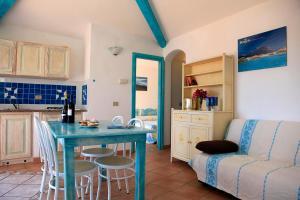 Een zitgedeelte bij Residence Hotel Lu Nibareddu