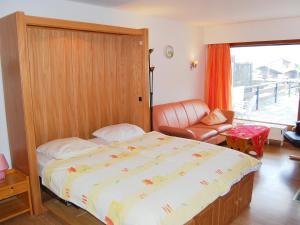 Ein Bett oder Betten in einem Zimmer der Unterkunft Apartment Cerisiers D-Rez