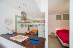 A kitchen or kitchenette at Casetta Rossa