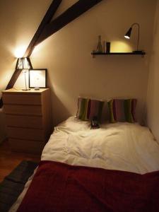 En eller flere senge i et værelse på Appartement Hellfritzsch