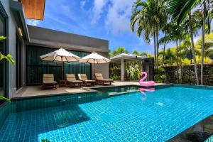 The swimming pool at or near Baan Bua Villa by Railand