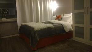 A bed or beds in a room at Piriko Studio Apartments