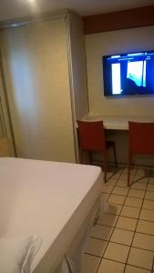 A bed or beds in a room at Boa Viagem Flat BVF 777