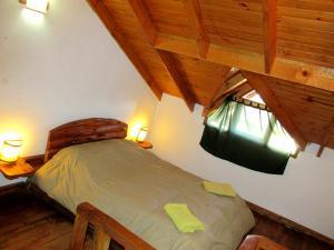 A bed or beds in a room at Alto Rolando Apartamentos