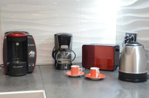 Coffee and tea making facilities at Carré d'or Very nice appart Near the beach